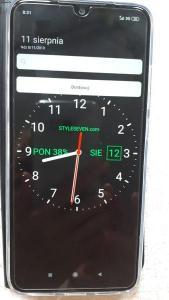 Zdjęcie przedmiotowego zegara z dwoma paskami.jpg